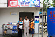 Aniema Edem (middle) with Peace (right) and Ngozi (left) from Youth for Technology.<br /> <br /> Aniema runs Rasa Venture, a frozen food and ice business.<br /> <br /> Aniema was a contractor living in Lagos, working for ExxonMobile. She used to travel home to this area to visit her aging parents and she noticed that the convenient frozen food, widely available in Lagos, were not available in Uyo. She saw a gap in the market and decided to establish her business. <br /> <br /> She is a member of a women's business group and through them heard about Youth for Technology's training and the business support text messaging service.<br /> <br /> The main things she learnt from the training was around risk management and from the text messaging it was around staff management.