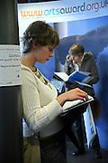 Women reading through the days program of events. .Stratford Circus 9th November 2006