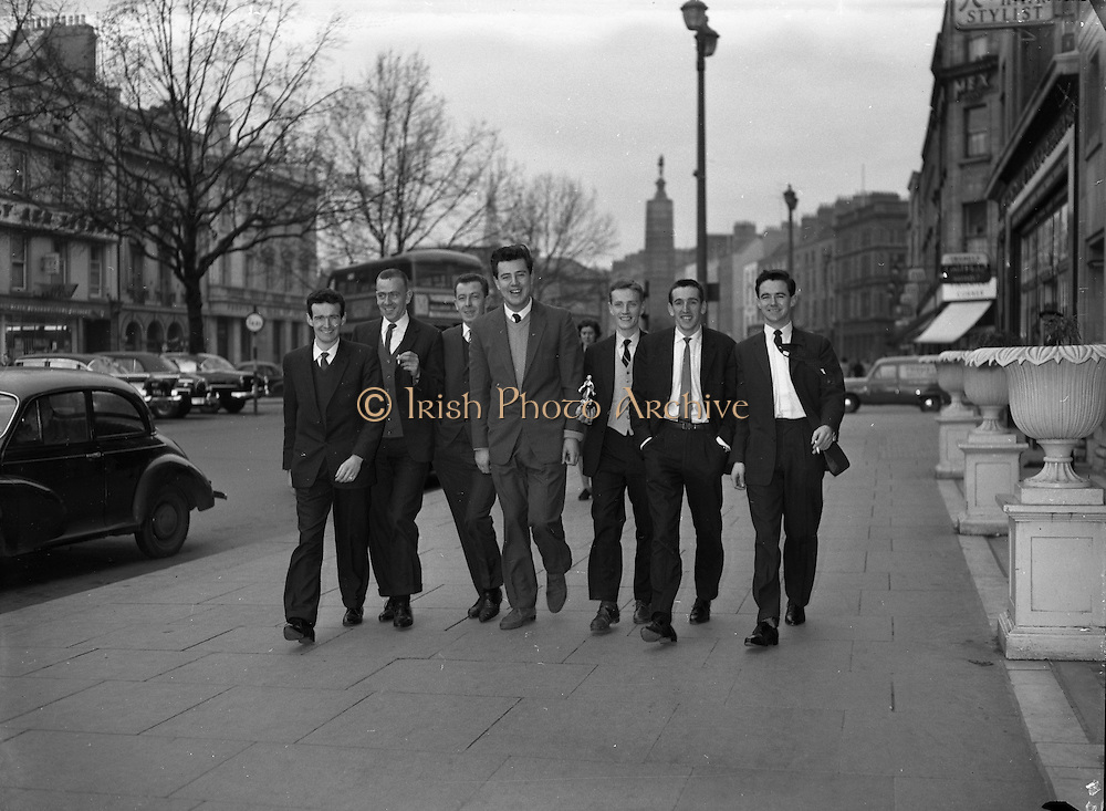Royal Showband return with trophy..1962..06.02.1962..02.06.1962..6th February 1962..Members of the Royal Showband, from Waterford, pictured with the Carl Alan award, which they received in London the previous night. From left: Tom Dunphy, Gerry Cullen, Eddie Sullivan, Brendan Bowyer, Michael Coppinger, Charlie Matthews, Jim Conlon..The Band are pictured as they stroll down O'Connell Street, Dublin.