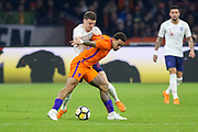 England defender Kieran Trippier battles with Netherlands forward Memphis Depay (Olympique Lyonnais), during the Friendly match between Netherlands and England at the Amsterdam Arena, Amsterdam, Netherlands on 23 March 2018. Picture by Phil Duncan.
