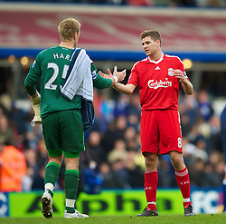 BIRMINGHAM, ENGLAND - Sunday, April 4, 2010: Liverpool's captain Steven Gerrard MBE and Birmingham City's goalkeeper Joe Hart during the Premiership match at St Andrews. (Photo by David Rawcliffe/Propaganda)
