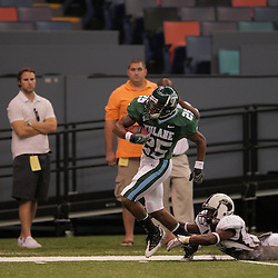 20 September 2008: Tulane running back Albert Williams (25) escapes the tackle Louisiana-Monroe linebacker Jeremy Moll (35) during a 37-yard touchdown run during the first quarter of a Conference USA match up between the University of Louisiana Monroe and Tulane at the Louisiana Superdome in New Orleans, LA.