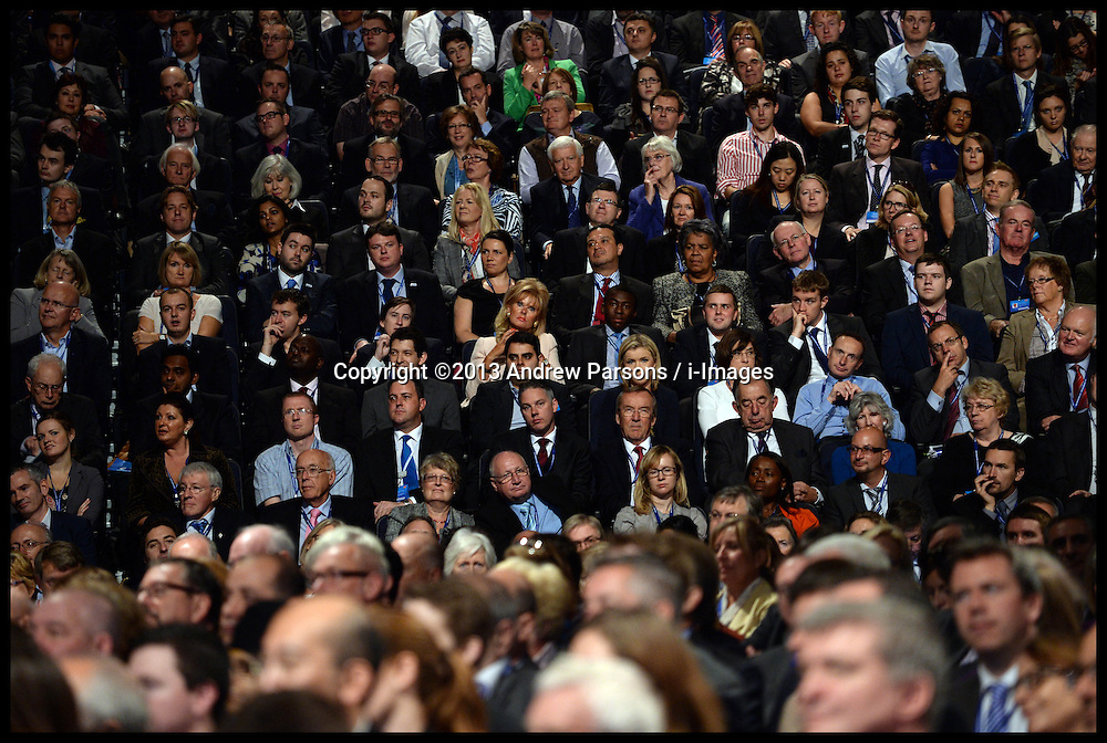 People watch the Mayor of London Boris Johnson's speech  at the Conservative Party Annual Conference. Manchester, United Kingdom. Tuesday, 1st October 2013. Picture by Andrew Parsons / i-Images