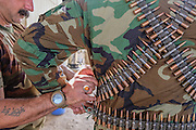 Peshmerga fighters secure a heavy machine gun cartridge belt at the Mount Batiwa frontline. Iraqi Kurdistan.
