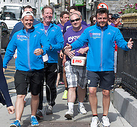 "03/06/2014 After walking 108 miles from Donegal to Galway, Ronnie Whelan's ""Myaware.ie Annual Walk"" in aid of Myasthenia, arrive at Hotel Meyrick in Galway city centre was Danny O'Carroll aka Buster from Mrs. Brown's boys son of Brendan, Ronnie Whelan and Mick Delaney and Love/Hate's Elmo Laurence Kinlan. Photo:Andrew Downes"