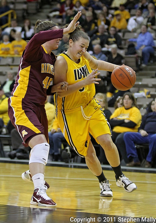 February 10 2011: Iowa Hawkeyes forward Kalli Hansen (3) tries to get around Minnesota Golden Gophers forward Jackie Voigt (45) during the first half of an NCAA women's college basketball game at Carver-Hawkeye Arena in Iowa City, Iowa on February 10, 2011. Iowa defeated Minnesota 64-62.