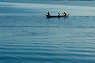 fishermen on rowboat near U Bein bridge at Amarapura