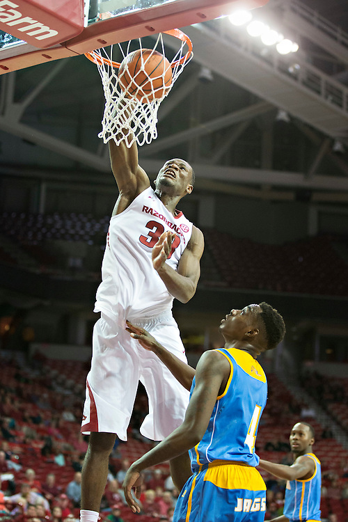 FAYETTEVILLE, AR - NOVEMBER 13:  Moses Kingsley #33 of the Arkansas Razorbacks block dunks the ball over Chris Thomas #4 of the Southern University Jaguars at Bud Walton Arena on November 13, 2015 in Fayetteville, Arkansas.  The Razorbacks defeated the Jaguars 86-68.  (Photo by Wesley Hitt/Getty Images) *** Local Caption *** Moses Kingsley; Chris Thomas