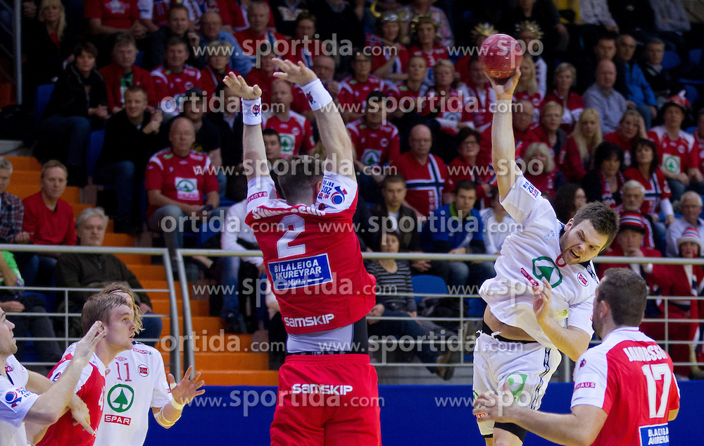 Vignir Svavarsson of Iceland vs Vegard Samdahl of Norway during handball match between Iceland and Norway in  2nd Round of Preliminary Round of 10th EHF European Handball Championship Serbia 2012, on January 18, 2012 in Millennium Center, Vrsac, Serbia. Iceland defeated Slovenia 34-32. (Photo By Vid Ponikvar / Sportida.com)