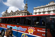Tour bus waiting for tourists on Havana's parque central.