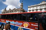 Tour bus waiting for tourists on Havana's parque central.