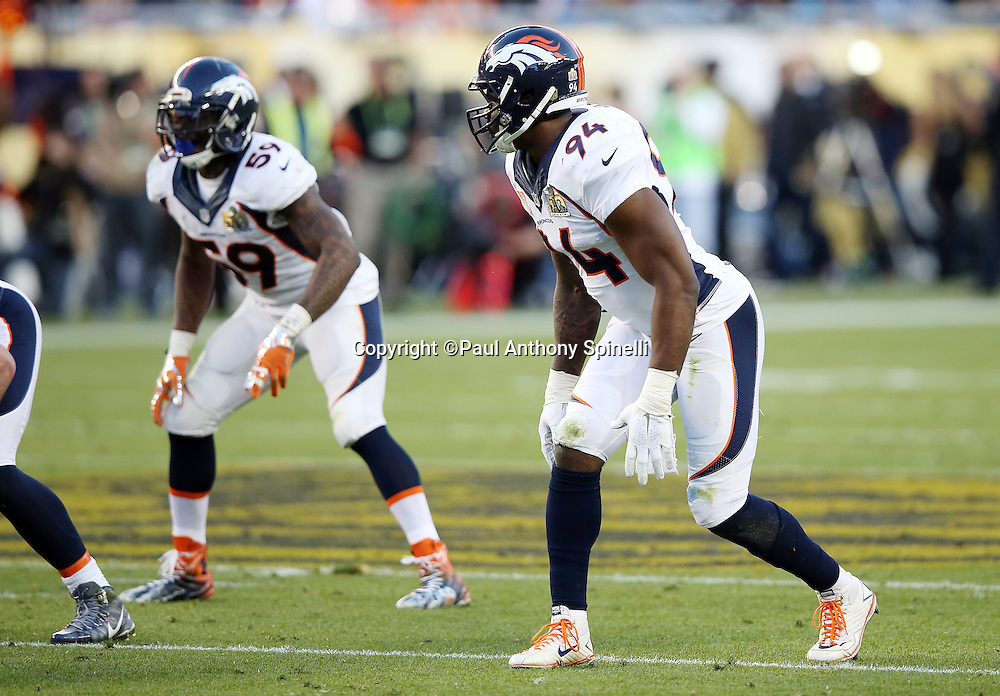 Denver Broncos outside linebacker DeMarcus Ware (94) and Denver Broncos inside linebacker Danny Trevathan (59) get set for the snap during the NFL Super Bowl 50 football game against the Carolina Panthers on Sunday, Feb. 7, 2016 in Santa Clara, Calif. The Broncos won the game 24-10. (©Paul Anthony Spinelli)