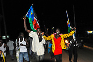Just before midnight on the eve of independence, Southern Sudanese begin celebrating in the streets of the capital city.<br /> Juba, South Sudan. 08/07/2011.
