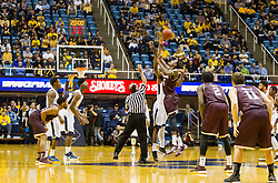 Dec 13, 2015; Morgantown, WV, USA; West Virginia Mountaineers forward Jonathan Holton (1) and Louisiana Monroe Warhawks forward Jamaal Samuel (5) jump to begin the game at WVU Coliseum. Mandatory Credit: Ben Queen-USA TODAY Sports