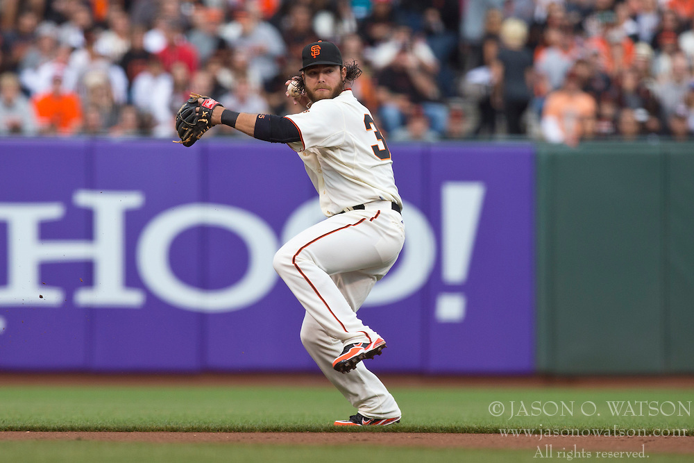 SAN FRANCISCO, CA - MAY 05: Brandon Crawford #35 of the San Francisco Giants throws to first base against the Los Angeles Dodgers during the first inning at AT&T Park on May 5, 2013 in San Francisco, California. The San Francisco Giants defeated the Los Angeles Dodgers 4-3. (Photo by Jason O. Watson/Getty Images) *** Local Caption *** Brandon Crawford