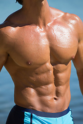 detail of a very sexy man's body in a bikini outdoors