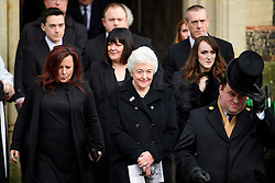 © Licensed to London News Pictures. 01/02/2017. Watford, UK. RITA TAYLOR (front centre), wife of Graham Taylor is joined by other family members as they leave the church, following the funeral of former England football team manager Graham Taylor at St Mary's Church in Watford, Hertfordshire. The former England, Watford and Aston Villa manager,  who later went on to be chairman of Watford Football Club, died at the age of 72 from a suspected heart attack. Photo credit: Ben Cawthra/LNP