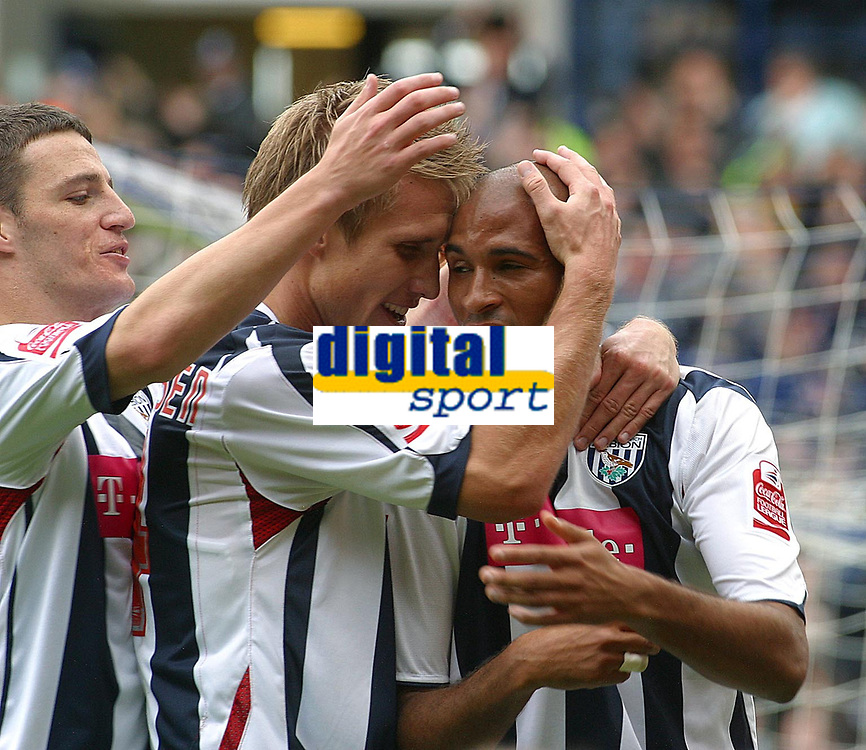 Photo: Dave Linney.<br />West Bromwich Albion v Wolverhampton Wanderers. Coca Cola Championship. 22/10/2006. West Brom's Diomansy Kamara  celebrates after making it 2-0 the the Baggies.