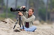 Female Photographer on Beach (MR)