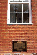 Dedication plaque and window at the Columbia school house, Columbia State Historic Park, Highway 49, Gold Country, California