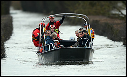 Prince Charles gets a lift on a rescue boat after visiting Flood Victims on the Somerset Levels, South West England. Members of the community have been cut off by the floods for most of 2014. Tuesday, 4th February 2014. Picture by Andrew Parsons / i-Images