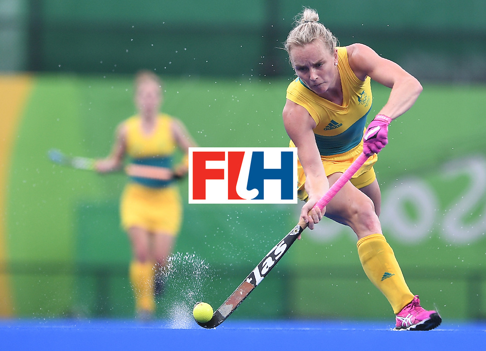 Australia's Jane-Anne Claxton hits the ball during the women's field hockey India vs Australia match of the Rio 2016 Olympics Games at the Olympic Hockey Centre in Rio de Janeiro on August, 10 2016. / AFP / MANAN VATSYAYANA        (Photo credit should read MANAN VATSYAYANA/AFP/Getty Images)