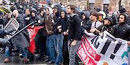 Roma 3 Dicembre 2014<br /> Manifestazione  di precari, studenti e il sindacato Cobas contro il Jobs Act in centro a Roma. Il corteo ha  tentato di arrivare al Senato dove  iniziato il dibattito  sul provvedimento ma &egrave; stato fermato dalla polizia. La polizia carica i manifestanti in via delle Botteghe Oscure.<br /> Rome December 3, 2014<br /> Demostration of temporary workers, students and the union Cobas against the Jobs Act in downtown Rome. The procession attempted to get to the Senate, where the debate began on the measure but was stopped by the police. Police charge protesters in  Botteghe Oscure street.