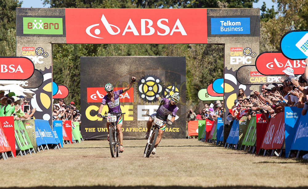 Grand Masters winners Heinz Zoerweg(L) and Barti Bucher(R) cross the line of the final stage (stage 7) of the 2013 Absa Cape Epic Mountain Bike stage race from Stellenbosch to Lourensford Wine Estate in Somerset West, South Africa on the 24 March 2013..Photo by Sam Clark/Cape Epic/SPORTZPICS