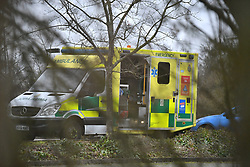 © Licensed to London News Pictures. 09/02/2020. Milton Keynes, UK. An ambulance seen at the facility before Passengers evacuated from Wuhan in China arrive at a facility in Milton Keynes, Buckinghamshire. Around 150 Britons on the most recent UK government flight back from the centre of the coronavirus outbreak in China are being housed at Kents Hill Park Conference Centre in Milton Keynes for a 14-day quarantine. . Photo credit: Ben Cawthra/LNP