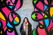 University of Pennsylvania student Anisa Hasan-Granier stands in front of a large mural near the University of Pennsylvania in Philadelphia, Pennsylvania on December 14, 2017.