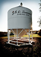 A grain bin is captioned with the farmer's business name, Birch Hills, Saskatchewan.
