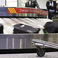 "Airport luggage carousel ""Danger"" sign."