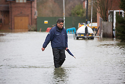 Alok Sharma the Conservative MP for Reading West visiting  the  floods in Purley on Thames, Reading, United Kingdom. United Kingdom,Tuesday, 11th February 2014. Picture by i-Images