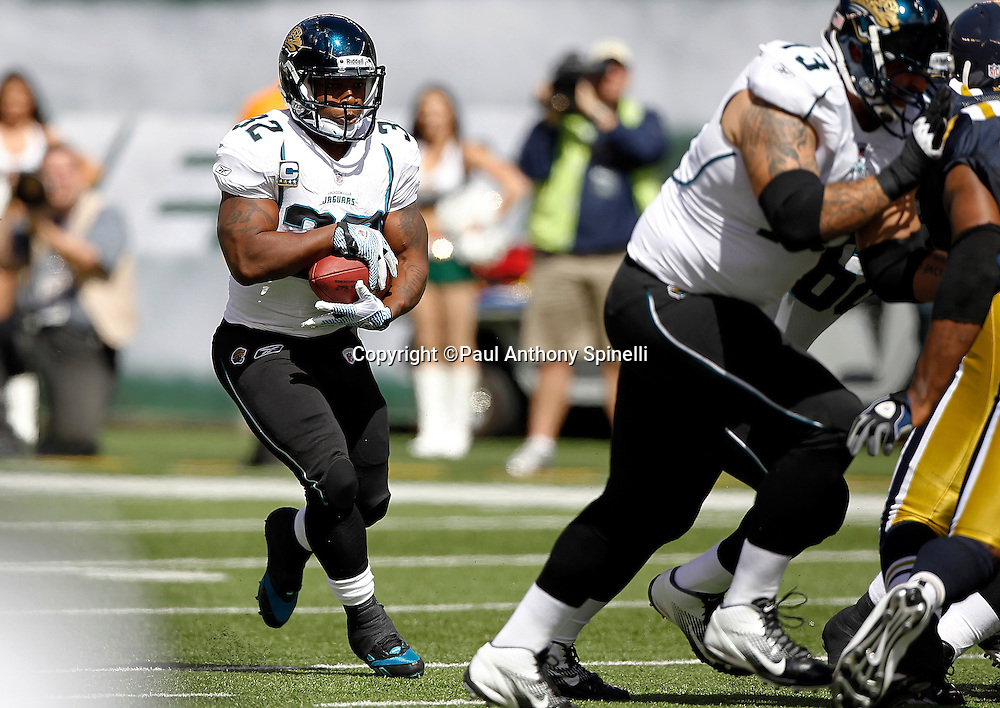 Jacksonville Jaguars running back Maurice Jones-Drew (32) runs the ball during the NFL week 2 football game against the New York Jets on Sunday, September 18, 2011 in East Rutherford, New Jersey. The Jets won the game 32-3. ©Paul Anthony Spinelli