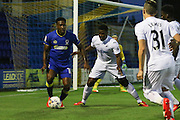 Swansea City U23 defender Tyler Reid (47) and AFC Wimbledon striker Dominic Poleon (10) during the EFL Trophy match between AFC Wimbledon and U23 Swansea City at the Cherry Red Records Stadium, Kingston, England on 30 August 2016. Photo by Stuart Butcher.