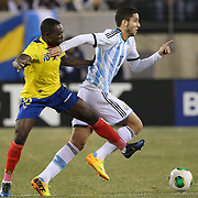 Ricardo Álvarez, (right), Argentina, is challenged by Walter Ayovi, Ecuador, during the Argentina Vs Ecuador International friendly football match at MetLife Stadium, New Jersey. USA. 15th November 2013. Photo Tim Clayton