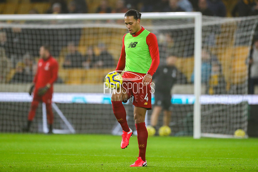Liverpool defender Virgil van Dijk (4) warms up ahead of the Premier League match between Wolverhampton Wanderers and Liverpool at Molineux, Wolverhampton, England on 23 January 2020.