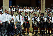 Schoolchildren with South African and United Kingdom flags in South Africa