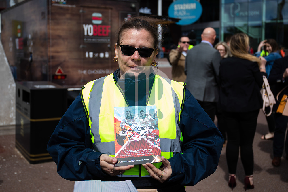 A programme seller outside of the stadium<br /> <br /> Photographer Simon King/Replay Images<br /> <br /> Guinness PRO14 Round 21 - Dragons v Scarlets - Saturday 27th April 2019 - Principality Stadium - Cardiff<br /> <br /> World Copyright © Replay Images . All rights reserved. info@replayimages.co.uk - http://replayimages.co.uk