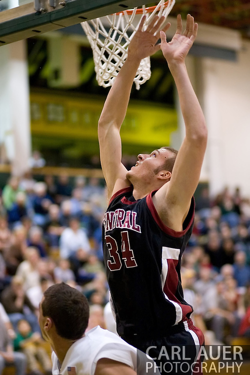 1/6/2006: Bryce Daub of the Central Washington Wildcats goes for 2 points in the 60-80 loss to the University of Alaska-Anchorage, 80-60 at the Wells Fargo Sports Complex on the campus of UAA.<br />