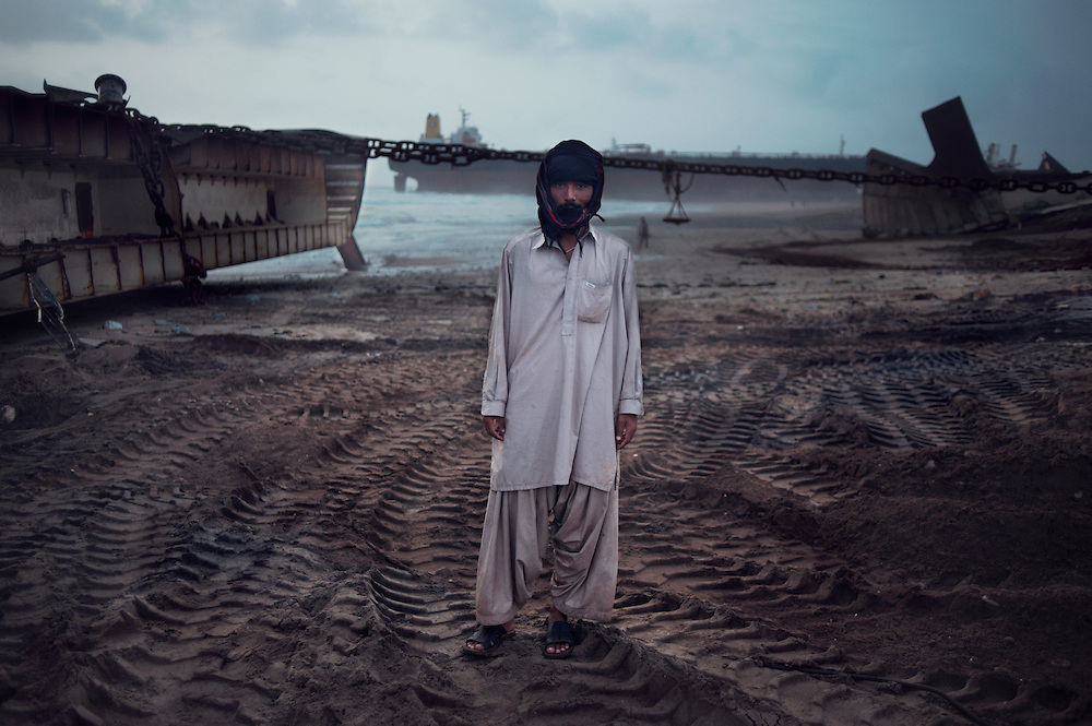Security guard Ehsan Hussain, 19 years old at the Gaddani Ship Breaking Yard, Balochistan Province, Pakistan on August 16, 2011. He is from Sindh Province.