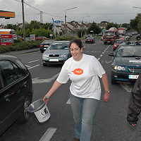 """26/08/05<br /> Muire Hopkins, Roscommon, and Dave McDonagh, Sligo, who are members of Young Fine Gael collecting money from motorists in Ennis as part of there walk from Galway to Limerick to raise funds and highlight the work of """"AWARE"""", who work to help combat depression in Ireland. <br /> Picture. Cathal Noonan/Press22."""