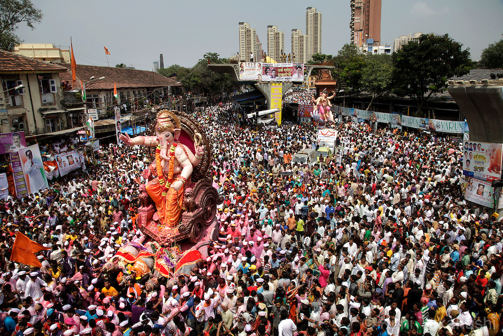 Ganesha idols is carried on the street in Mumbai, India on Sep 22, 2010 on the last day of Ganpati festival. The 10-day hindu festival, celebrating the birthday of Lord Ganesha who is widely worshiped as the god of wisdom, prosperity and good fortune, attracts tens of thousands people.<br /> Photo by Kuni Takahashi