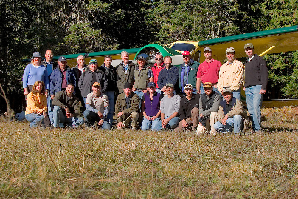 2005 Backcountry Safari Group poses in front of Harrison Ford's de Havilland Beaver prior to departing Moose Creek USFS Airport in Moose Creek, Idaho.