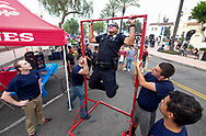 A police office does the straight bar dip during National Night Out in San Gabriel, California, on Tuesday, Aug. 1, 2017. National Night Out is a community-police awareness-raising event in the United States and Canada, held the first Tuesday of August. Texas and Florida have the option to use the alternate date of the first Tuesday in October to avoid hot weather.(Photo by Ringo Chiu)<br /> <br /> Usage Notes: This content is intended for editorial use only. For other uses, additional clearances may be required.
