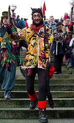 © Licensed to London News Pictures. 06/01/2013. London, UK. A member of the 'Bankside Mummers' dressed as 'Beelzebub' walks down steps to the Thames to meet the 'Holly Man' during the annual 'Twelfth Night' Celebration in London today (06/01/13). The tradition, a pagan celebration of the new year and the end if Christmas, takes place every year at Bankside outside the Globe Theatre and sees the actors of the Bankside Mummers perform for the public. Photo credit: Matt Cetti-Roberts/LNP