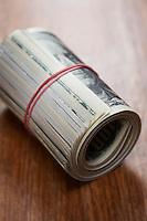 Roll of dollar bills close-up