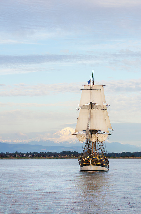 Lady Washington at sail in Semiahmoo Bay, Washington. Mount Baker is in the distance. A historic replica of the original 18th Century brig. Owned and operated by the Grays Harbor Historical Seaport, Aberdeen, Washington