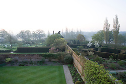 View over the gardens at Sissinghurst Castle at dawn