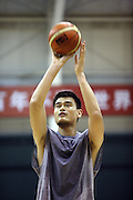Chinese basketball star Yao Ming works out with China's National Basketball team in Beijing.